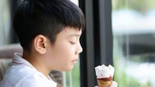 Little asian cute boy enjoy eating an ice cream