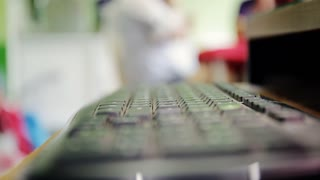 Man buying with credit card, using computer keyboard