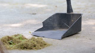Man sweeping ground with a broom