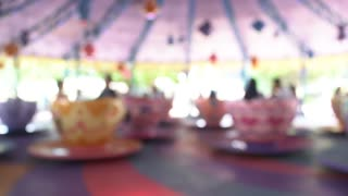 Motion blur of plaything big cup in the amusement park