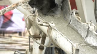 Non identify Construction workers pour concrete mix from cement mixer.Slow motion 120 fps.