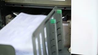 office man using paper copy machine