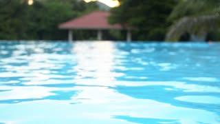 Old man swimming to side of pool, Asian senior man swimming in pool