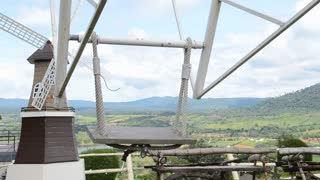 PETCHABOON,THAILAND-AUG 11,2014:Wellcome windmill with mountain landscape view background