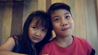 Portrait of asian kids, happy asian boy and girl looking at camera and smiling. Sequence