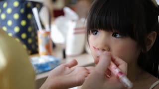profession makeup artist working with young asian cute child
