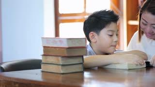 Reading with teacher - an elementary school boy reads aloud to her teacher