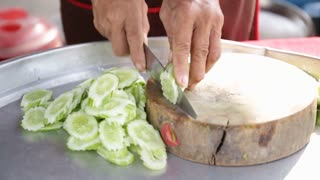 Restaurant kitchen woman preparing fish dishes for customer .