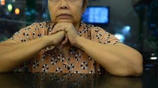 Seniors portrait, contemplative old caucasian woman staring at camera