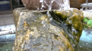 Slow Motion of Rock Ball fountain.