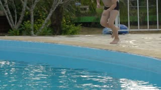 Slow motion of Young Asian boy having fun at pool, happy asian child playing in pool.