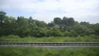 train passing through countryside, moving railroad tracks