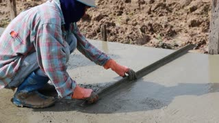 Unidentified Construction workers make shape concrete road.Road work, street repair