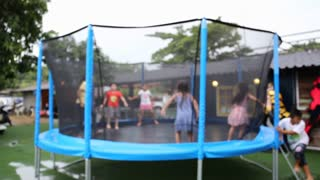 Unidentify Kids jumping on trampoline .