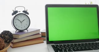 4K : A laptop computer with a key green screen set on work office table.Dolly move left to right