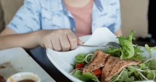 Asian boy enjoy eating salad Healthy concept .