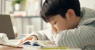 Asian boy reading cartoon books at home ,Dolly shoot.