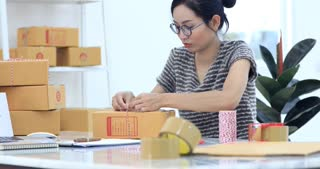 Asian Woman Working at home with Online Business or SME Concept. Young owner happy woman Start up for Business Online happy with orders.