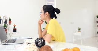 Asian woman Working at home with Online Business.Asian woman is working with financial documents at workplace in the office.