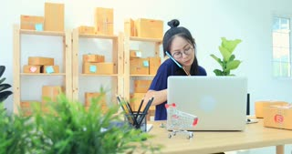 Asian Woman Working at home, Young business start up with Online Business or SME Concept.