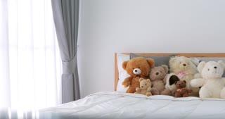 Girl room with teddy bear on bed