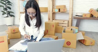 Happy asian cute woman working at home with smile face.oung business start up. Young Asian Woman Working at home, Young Owner Woman Start up for Business Online, SME