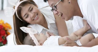 Happy asian family baby with parent make fun at home with smile face.