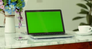 Laptop with key green screen.