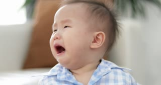 Little asian boy crying