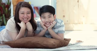 Portrait of asian family mother and son looking at camera and acting on your face together.