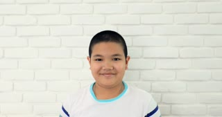 Portrait of young asian child with acting smile angry on your face.