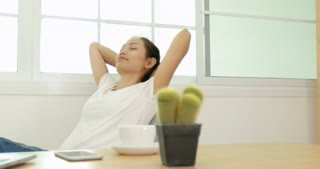 Pretty Asian Business Woman Stretching Relax and Working With Computer Notebook