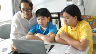 Tutor room children in class learning on laptop computer with teacher. 4K Slow motion Asian child learning with teacher at home.