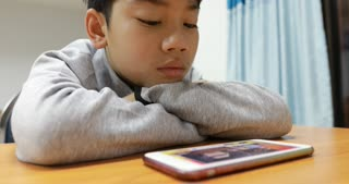 Young child watching video on a mobile phone