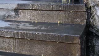 water flood over concrete ladder