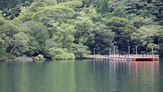 Wide angle while boating around HAKONE lake in JAPAN on sunny day.