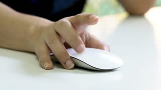 Woman Hand Using a Computer Mouse