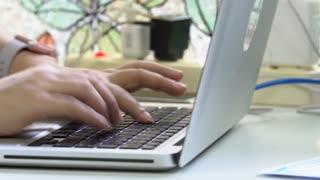 Work at a laptop,Female hands closeup, surfing internet,UHD 4k