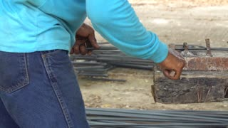 Worker bend steel line in to square shape. To construction building, A post which supports a beam-pile