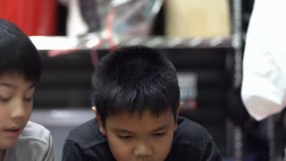 Young asian boy using digital tablet.