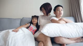 Young Asian family playing and Watching TV .