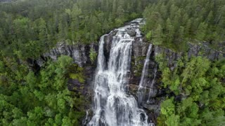 Aerial footage from Tvindefossen waterfall from the bird's-eye view, Norway