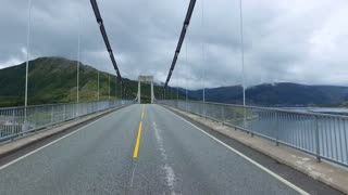 Road in Norway.Vehicle point-of-view driving over the bridge.