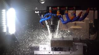 Metalworking CNC milling machine. Cutting metal modern processing technology. Slow motion 120 fps