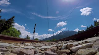 Quick passage of a passenger train on the rails bottom view. In the video there is sound