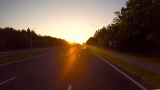 Timelapse car driving on the autobahn at sunrise
