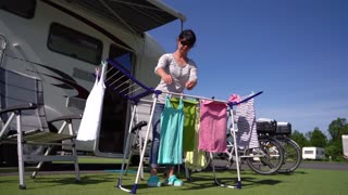 Washing on a dryer at a campsite. Caravan car VR Vacation. Family vacation travel, holiday trip in motorhome