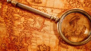 Vintage still life. Vintage magnifying glass lies on an ancient world map in 1565