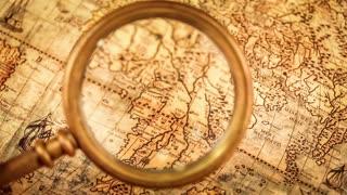 Vintage still life vintage magnifying glass lies on ancient world vintage magnifying glass lies on ancient world map in 1565 gumiabroncs Image collections