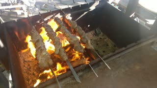 Barbecue Meat On Fire